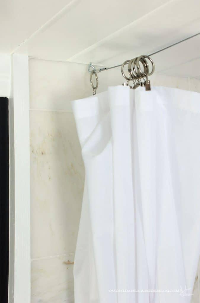 18-Subtle-Wire-Shower-Curtain-Rod-675x1024