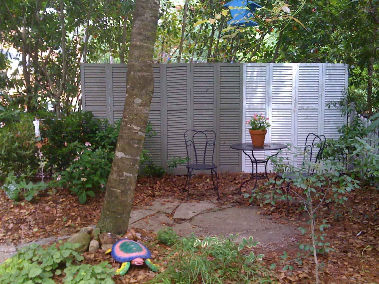 Make an Upcycled Shutter Privacy Wall